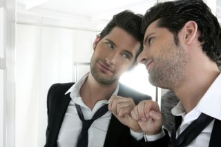 Narcissistic man looks in the mirror.