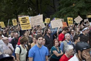 occupy wall street protest. calling a group radical or extreme undermines support