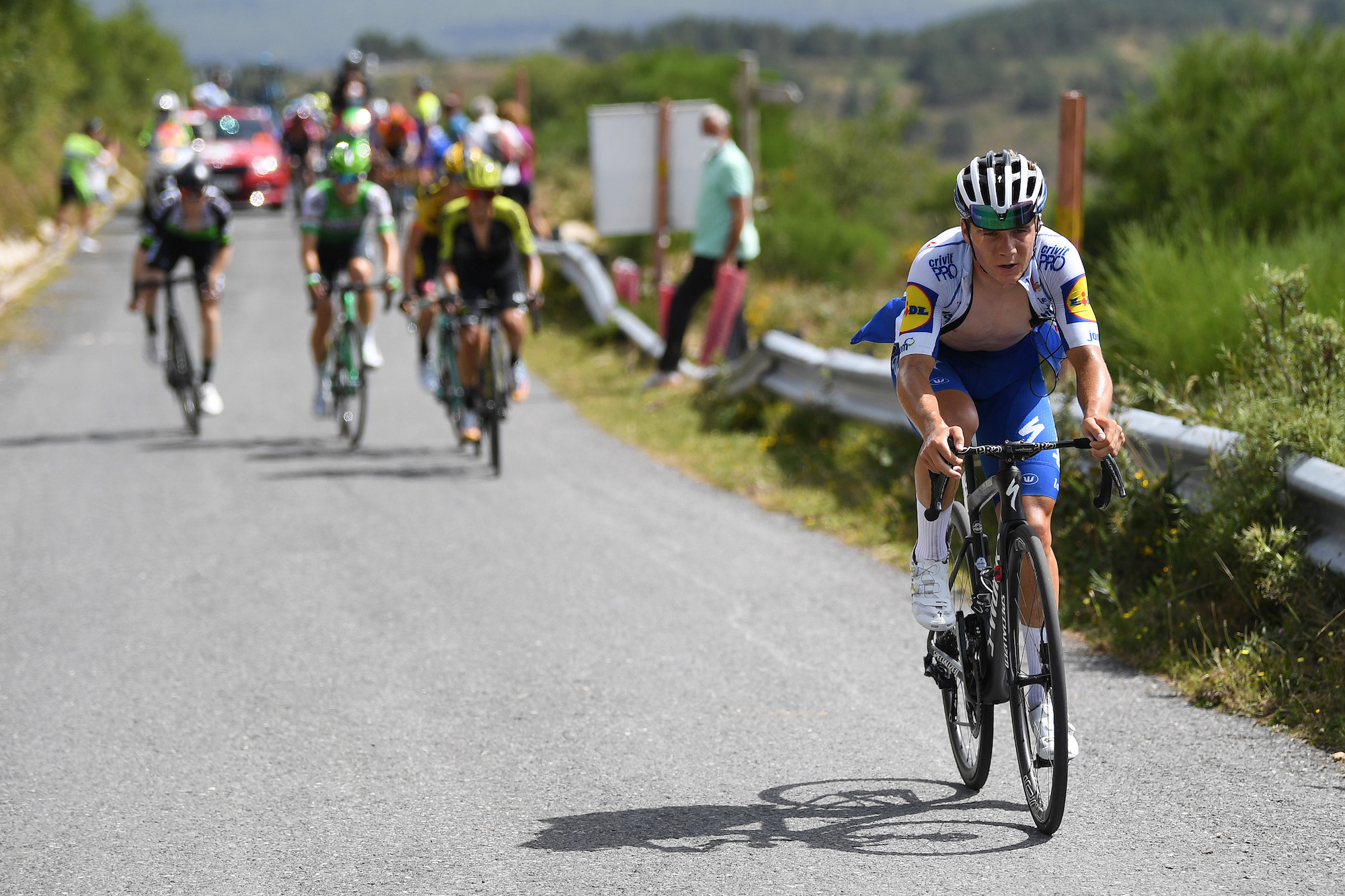 Watch: Riders battle insane winds on summit of Picón Blanco at Vuelta a Burgos - Cycling Weekly