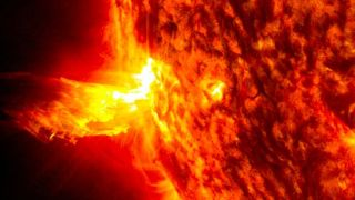 On June 20, 2013, at 11:15 p.m. EDT, the sun shot out a solar flare (left side), which was followed by an eruption of solar material shooting through the sun's atmosphere.