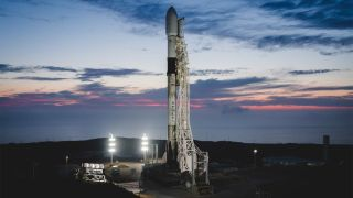 A used SpaceX Falcon 9 rocket carrying three Canadian Radarsat satellites stands ready to launch from Vandenberg Air Force Base, California. The rocket's first stage will launch a new Starlink mission from Florida on July 8, 2020.