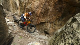 Payson McElveen rides the new Trek Top Fuel downcountry bike down a rocky chute