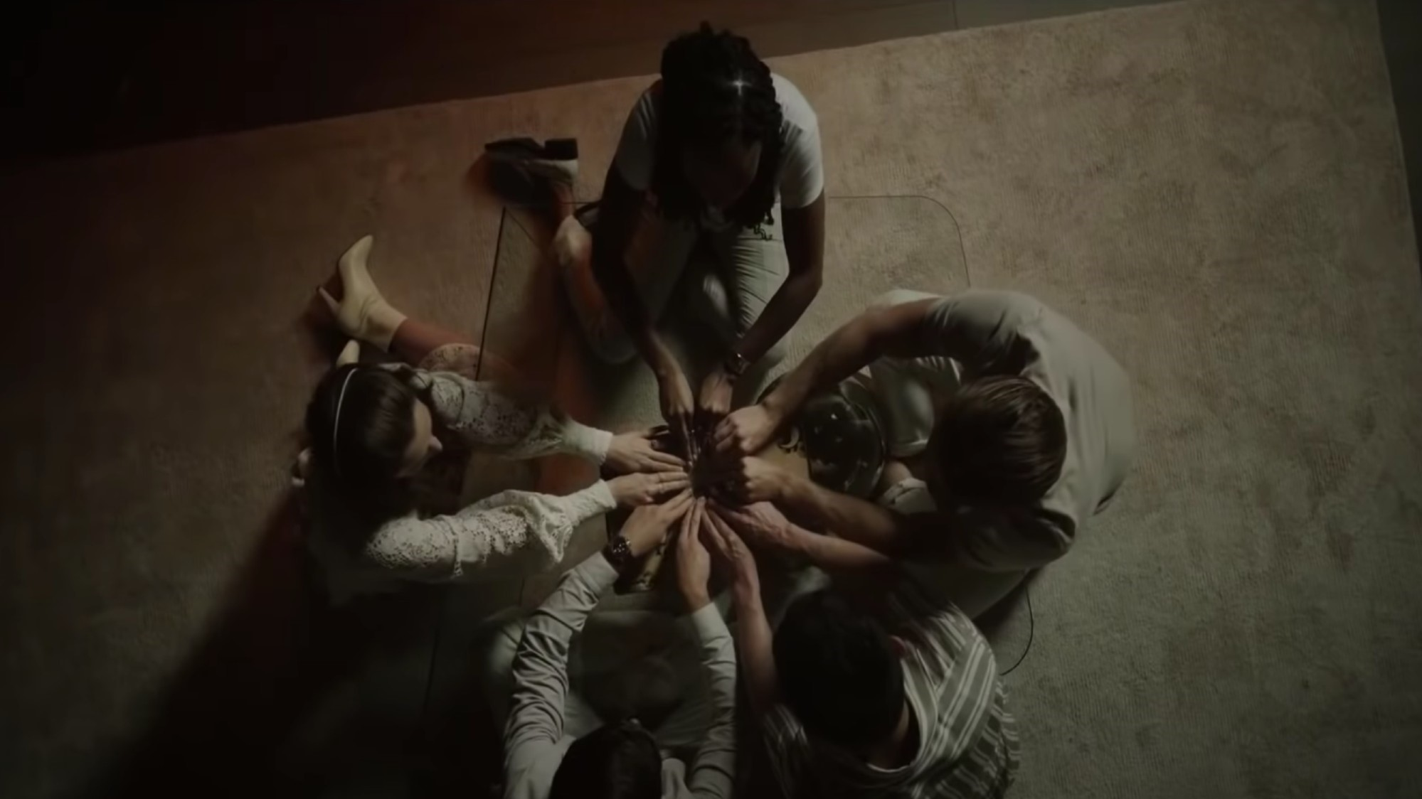 American Horror Stories screencap sees five people circled around calling to spirits