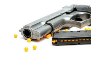A BB gun with pellets.