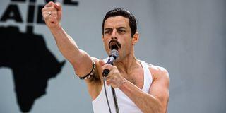 Rami Malek raises his fist during Live Aid in Bohemian Rhapsody.
