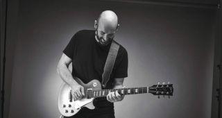 A guitarist plays a Gibson Les Paul