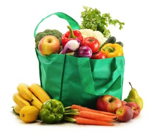 A canvas grocery bag full of fruit and vegetables