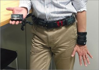 An image of a man wearing 12 fitness trackers.