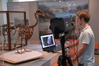 Here, researcher Andy Biedlingmaier scans the only known complete skeleton from a single dodo.