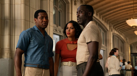 Tic (Jonathan Majors) Leti (Jurnee Smollett) and Montrose (Michael Kenneth Williams) look on at the museum.