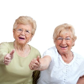 Older women giving thumbs up