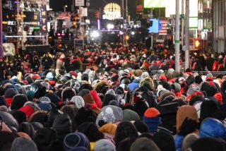 Revelers crowd Times Square ahead of the New Year's Eve celebration on December 31, 2017 in New York City.