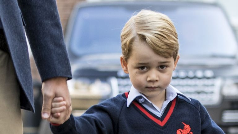 Prince George holding his parents hands
