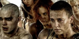 Imperator Furiosa (Charlize Theron) drives Nux, Capable and The Splendid Angharad in Mad Max: Fury Road