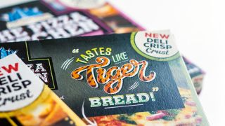 "Pizza Kitchen packaging with fun illustrated statement ""Tastes like tiger bread"""
