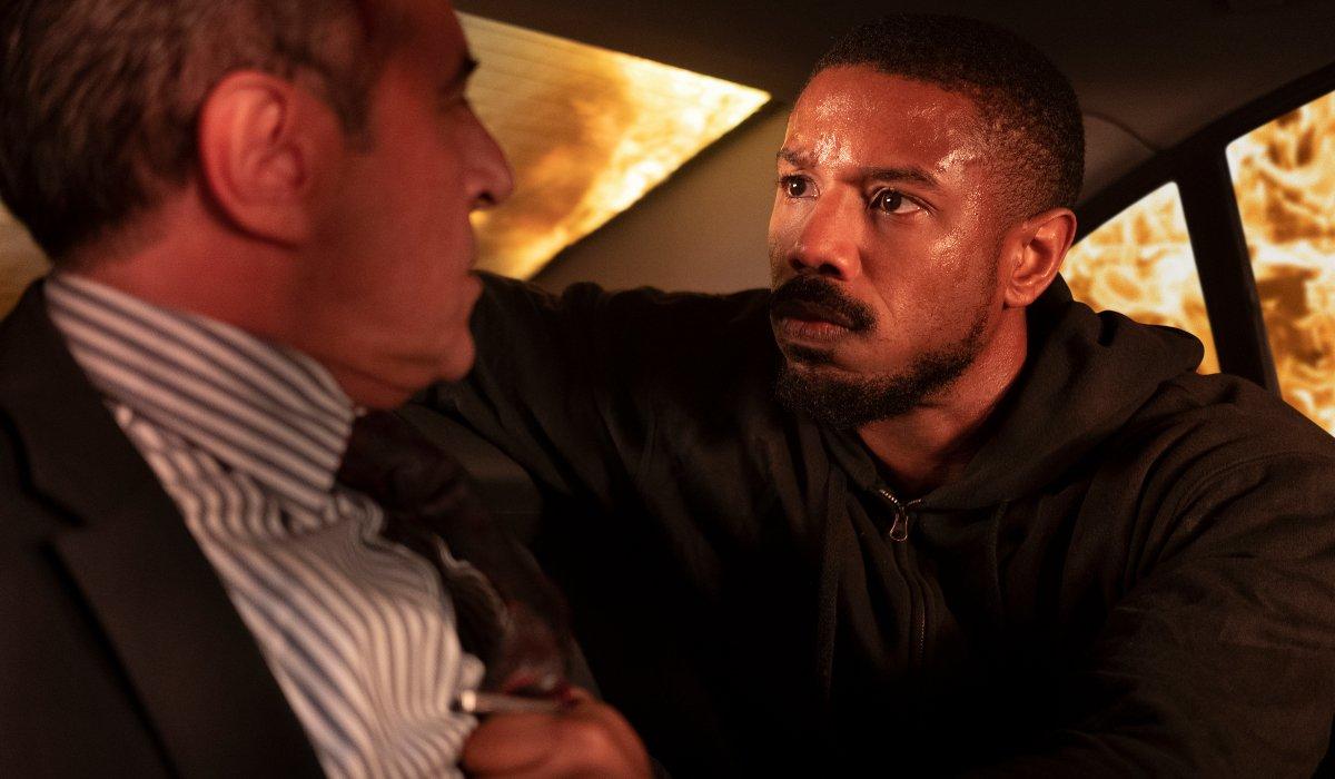 Michael B. Jordan interrogates a man in a burning car in Without Remorse.
