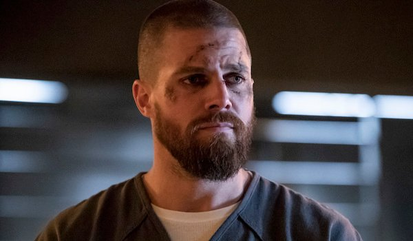 oliver beaten up in jail arrow season 7