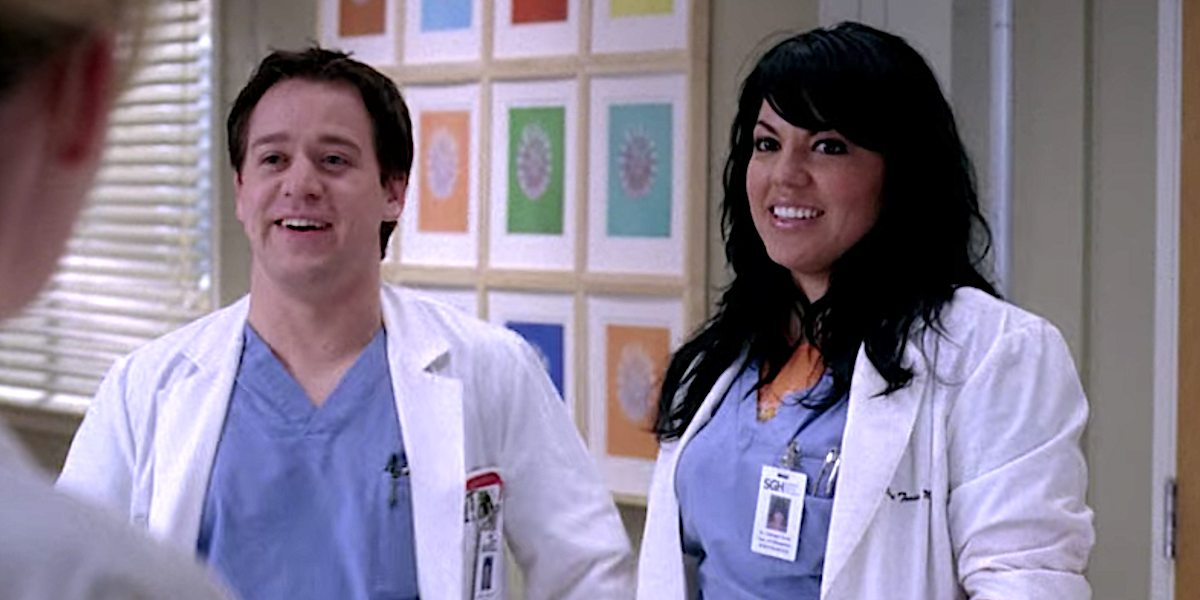 Grey's Anatomy George and Callie smile awkwardly in the hospital.