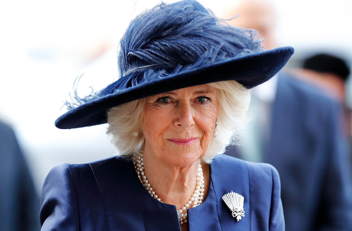 Duchess Camilla rocks casual chic with knee-high boots and Queen's favourite handbag brand