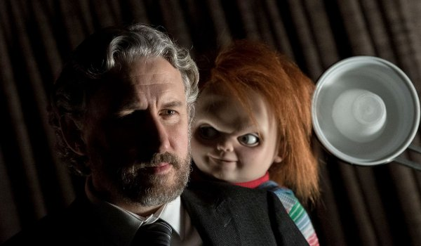 Cult of Chucky Dr. Foley being approached by Chucky from behind