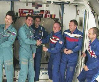 New Space Station Crew Takes Charge