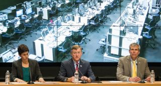 Rachel Kraft, NASA public affairs officer, left, Frank Culbertson, Executive Vice President and General Manager of Advanced Program Group at Orbital Sciences Corp., center, Bill Wrobel, director of NASA's Wallops Flight Facility, right, take questions fro