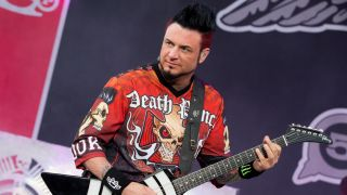 A photograph of Five Finger Death Punch guitarist Jason Hook