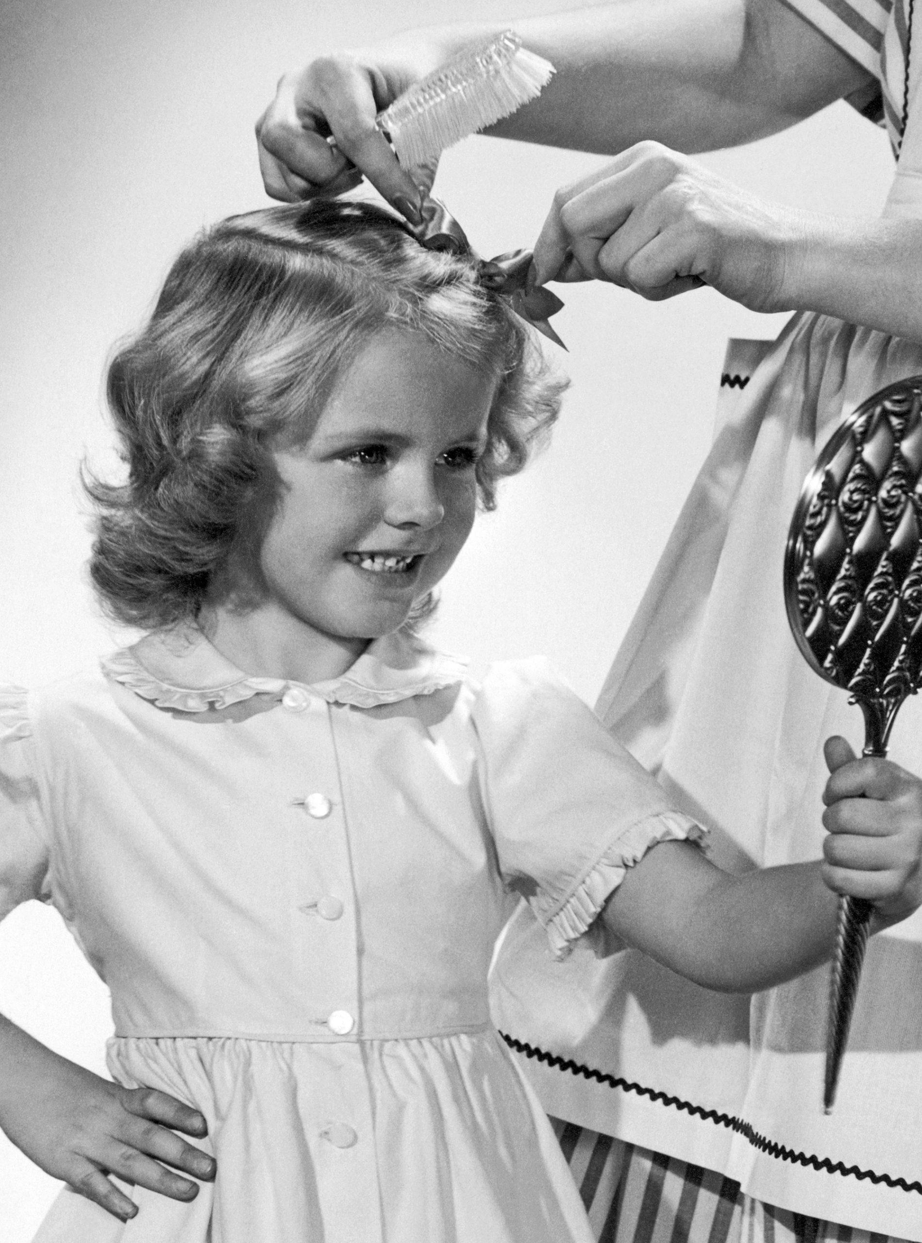 little girl doing hair