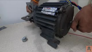 An oversized rumble pack for PC made out of a large motor