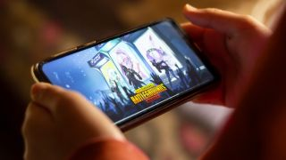 AS mobile phone showing a person playing PUBG Mobile