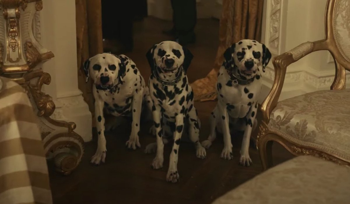 Three angry Dalmatians snarling in Cruella.