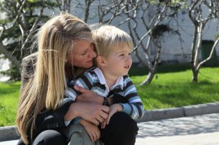 NASA astronaut Karen Nyberg shares a quiet moment with her 3-year-old son Jack during a tour of the Kremlin and Red Square in Moscow, Russia, on May 8, 2013.