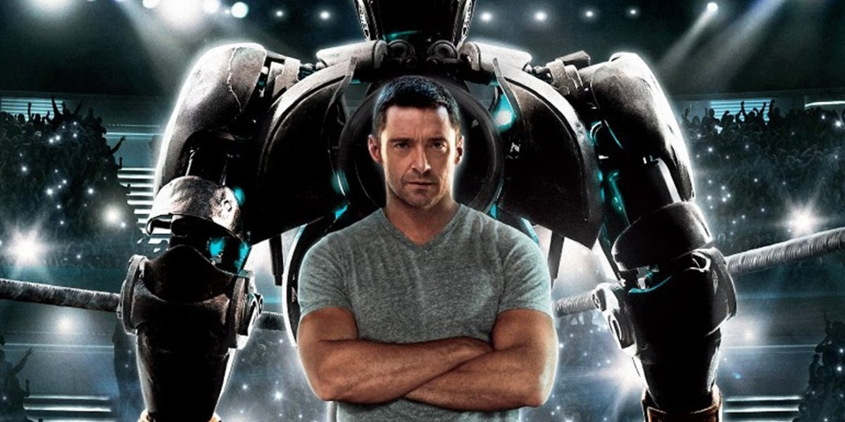 Real Steel Hugh Jackman stands in front of Atom's turned back