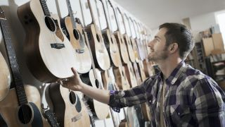 Man shopping for acoustic guitars