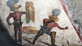 Two gladiators at the end of a fight — one victorious and the other yielding in defeat — appear on the latest fresco found in Pompeii.