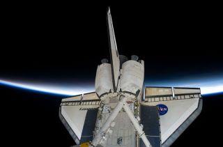 Cloudy Skies, Rain Delay Shuttle Discovery's Return to Earth