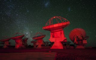 ALMA Antennae Bathed in Red Light Space Wallpaper