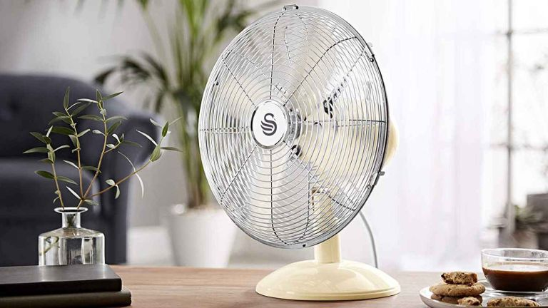 Swan SFA12620CN Cream Retro Fan on surface in living room
