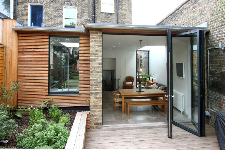 Home improvement loan: glass and wood extension attached to a home by IQ glass