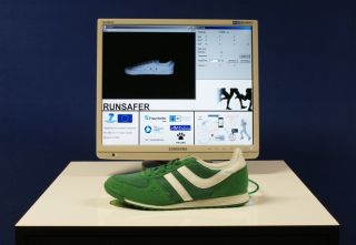 A smart running shoe is wired to a computer.