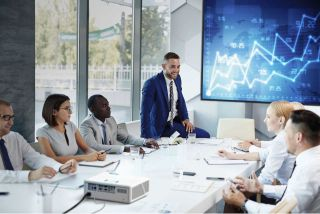 Business people at meeting with display screen