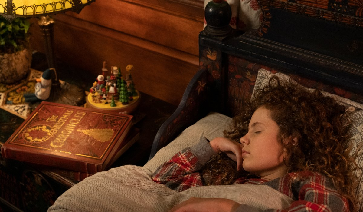 The Christmas Chronicles 2 Kate fast asleep, next to the storybook