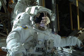 NASA astronaut Mike Hopkins looks to the camera during his first spacewalk on Dec. 21, 2013.