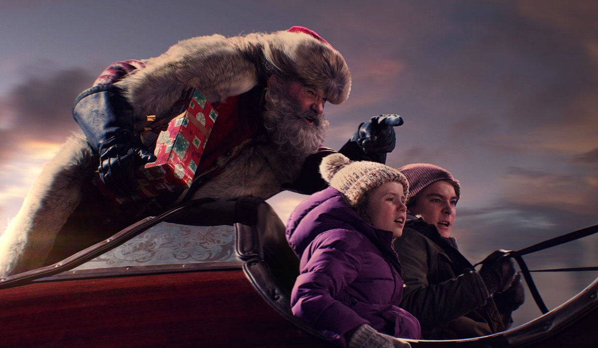 The Christmas Chronicles Kurt Russell riding in the back of the sleigh, giving directions