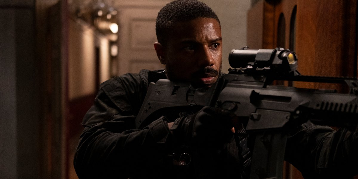 Michael B Jordan clears a hallway with his rifle in Without Remorse.