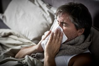 A man in bed with the flu.
