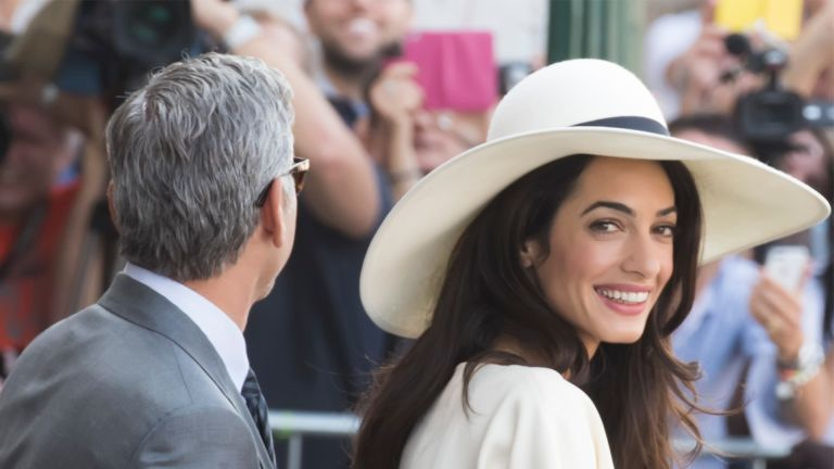 George Clooney and British fiancee, Amal Alamuddin arrive at Venice Town Hall to celebrate their wedding. (Photo by Marco Secchi/Corbis via Getty Images)