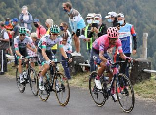 Team Education First rider Colombias Daniel Martinez R rides ahead of Team Bora rider Germanys Lennard Kamna C and Team Bora rider Germanys Maximilian Schachmann during the 13th stage of the 107th edition of the Tour de France cycling race 191 km between ChatelGuyon and Puy Mary on September 11 2020 Photo by KENZO TRIBOUILLARD AFP Photo by KENZO TRIBOUILLARDAFP via Getty Images