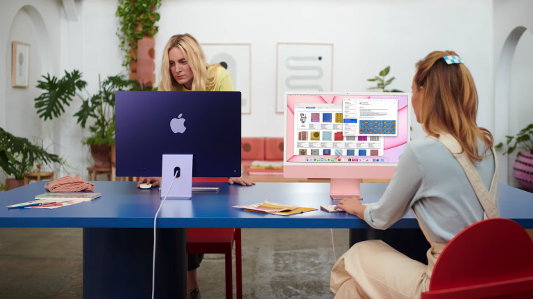 Best iMac deals 2021, image of two people working on iMacs in an office