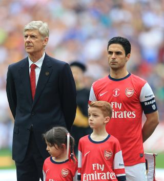 Arsene Wenger (left) and Mikel Arteta (right) won the FA Cup as manager and captain of Arsenal in 2014.
